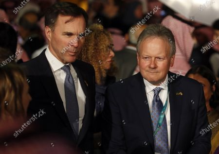 Stock Picture of Canadian Minister of Finance Bill Morneau (L) and the Bank of Canada governor Stephen Poloz (R) arrive at a historic site after the first meeting of Finance ministers and central bank governors of the G20, in Riyadh, Saudi Arabia, 22 February 2020. Finance ministers and central bank governors of the G20 are meeting in Riyadh on 22-23 February. Saudi Arabia will be hosting the 2020 G20 Leaders' Summit scheduled for 21-22 November.