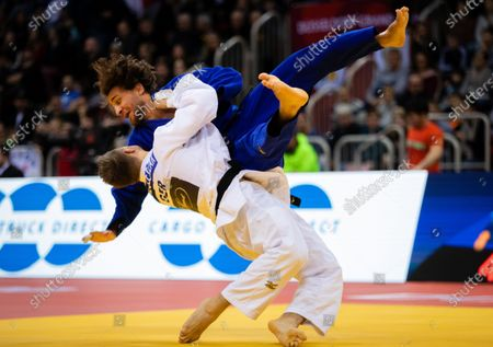 Alexander Wieczerzak of Germany (white) in action with Hidayet Heydarov of Azerbaijan (blue) during the men's -81kg round two match at the Dusseldorf Grand Slam judo tournament, in Duesseldorf, Germany, 22 February 2020.