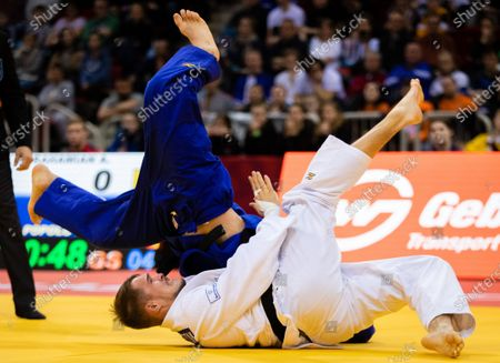 Stock Picture of Alexander Wieczerzak of Germany (white) in action with Hidayet Heydarov of Azerbaijan (blue) during the men's -81kg round two match at the Dusseldorf Grand Slam judo tournament, in Duesseldorf, Germany, 22 February 2020.