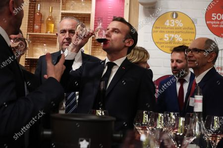 French President Emmanuel Macron tastes a glass of red wine during a visit to the 57th International Agriculture Fair (Salon international de l'Agriculture) at the Porte de Versailles exhibition center in Paris, 22 February 2020. The International Agriculture Fair 'Salon International de l'agriculture' (SIA) at the Paris Expo Porte de Versailles runs from 22 February to 01 March 2020.
