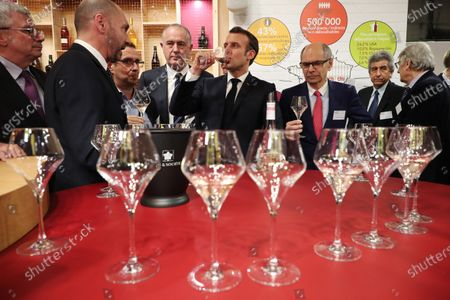 French President Emmanuel Macron tastes a glass of wine during a visit to the 57th International Agriculture Fair (Salon international de l'Agriculture) at the Porte de Versailles exhibition center in Paris, 22 February 2020. The International Agriculture Fair 'Salon International de l'agriculture' (SIA) at the Paris Expo Porte de Versailles runs from 22 February to 01 March 2020.