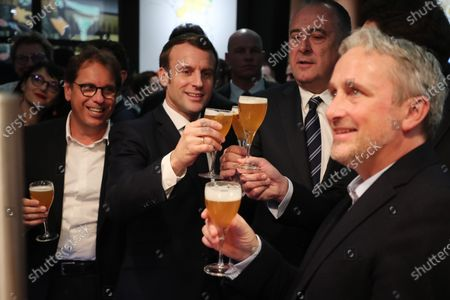 French President Emmanuel Macron holds a glass of beer during a visit to the 57th International Agriculture Fair (Salon international de l'Agriculture) at the Porte de Versailles exhibition center in Paris, 22 February 2020. The International Agriculture Fair 'Salon International de l'agriculture' (SIA) at the Paris Expo Porte de Versailles runs from 22 February to 01 March 2020.