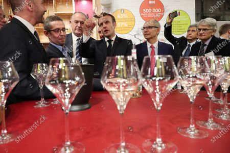 French President Emmanuel Macron holds a glass of wine during a visit to the 57th International Agriculture Fair (Salon international de l'Agriculture) at the Porte de Versailles exhibition center in Paris, 22 February 2020. The International Agriculture Fair 'Salon International de l'agriculture' (SIA) at the Paris Expo Porte de Versailles runs from 22 February to 01 March 2020.