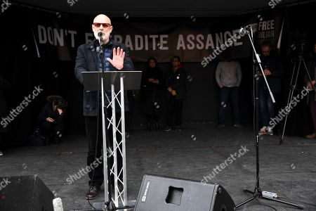 British musician Brian Eno speaks at a rally in Parliament Square as part of the demonstration against the extradition to the U.S. of Wikileaks founder, Julian Assange, in London,. Assange is fighting extradition to the United States on spying charges