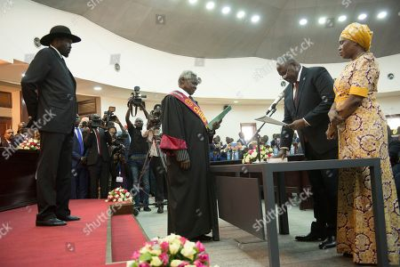 The president of South Sudan, Salva Kiir Mayardit, left, swears in Dr. Riek Machar as the first Vice President of South Sudan, in Juba, South Sudan . South Sudan opened a new chapter in its fragile emergence from civil war Saturday as rival leaders formed a coalition government