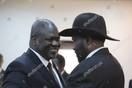 Stock Picture of The president of South Sudan, Salva Kiir Mayardit, right, and Dr. Riek Machar, left, greet each other after swearing in ceremony in Juba, South Sudan . South Sudan opened a new chapter in its fragile emergence from civil war Saturday as rival leaders formed a coalition government that many observers prayed would last this time around