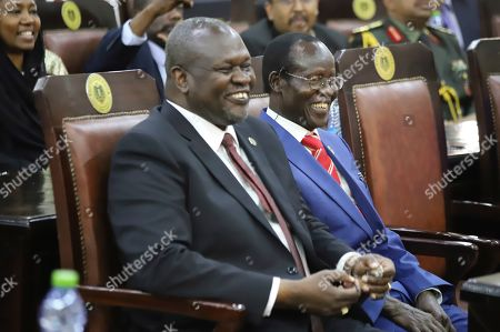 Dr. Riek Machar, left, after swearing in ceremony in Juba, South Sudan . South Sudan opened a new chapter in its fragile emergence from civil war Saturday as rival leaders formed a coalition government that many observers prayed would last this time around
