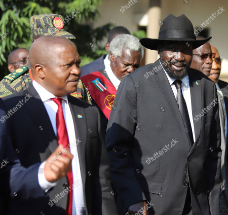 The president of South Sudan, Salva Kiir Mayardit, right, with Dabede Mabuza, Deputy president of South Africa, left, during swearing in ceremony in Juba, South Sudan . South Sudan opened a new chapter in its fragile emergence from civil war Saturday as rival leaders formed a coalition government that many observers prayed would last this time around