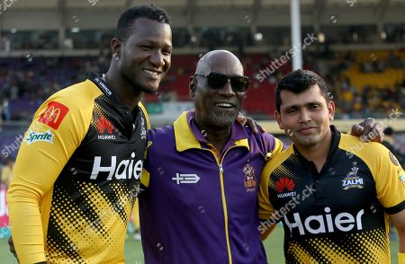 Stock Picture of Darren Sammy, Darren Sammy Kamran Akmal Vivian Richards. Peshawar Zalmi's players Darren Sammy, left, and Kamran Akmal, right, pose for photographer with former West Indies cricketer Vivian Richards, center, on end of Pakistan Super League T20 cricket match against Quetta Gladiators, in Karachi, Pakistan, . Pakistan is making former West Indies captain Sammy an honorary citizen for his role in restoring international cricket to the country. Pakistan will also give Sammy its highest civilian award - Nishan-e-Pakistan - the Pakistan Cricket Board tweeted Saturday