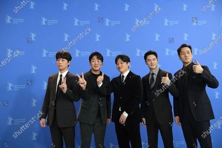 Stock Image of Park Jeong-min, Ahn Jae-hong, director Yoon Sung-hyun, Lee Je-hoon and Park Heo-soo pose during the 'Sa-Nyang-Eui-Si-Gan' photocall during the 70th annual Berlin International Film Festival (Berlinale), in Berlin, Germany, 22 February 2020. The movie is presented in the Berlinale Special section at the Berlinale that runs from 20 February to 01 March 2020.