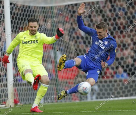 Danny Ward of Cardiff challenges Goalkeeper Jack Butland of Stoke City for the ball in the 1st half