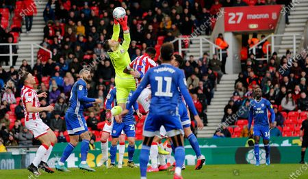 Goalkeeper Jack Butland of Stoke City saves from a cross by Albert Adomah of Cardiff