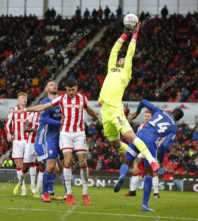 Goalkeeper Jack Butland of Stoke City saves from a throw in by Will Vaulks of Cardiff