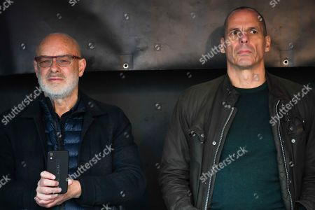 Greek economist Yannis Varoufakis, right, and British musician Brian Eno attend a rally in Parliament Square as part of the demonstration against the extradition to the U.S. of Wikileaks founder, Julian Assange, in London, . Assange is fighting extradition to the United States on spying charges