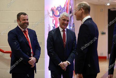 Prince William meets WRU Chief Executive Martyn Phillips and WRU Chairman Gareth Davies.