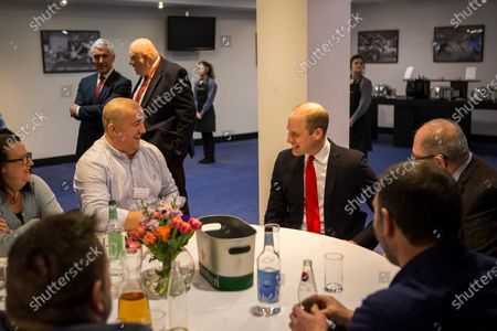 Prince William talks to injured players, members of the Welsh Rugby Charitable Trust before the game.
