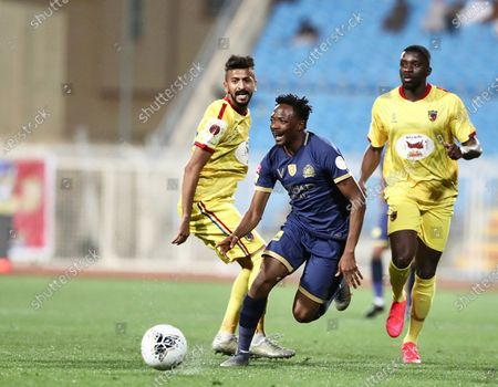 Al-Nassr's Ahmed Musa (C) in action against Al-Hazm's Osama Al-Khalaf (L) And Al-Hazm's Karim Yoda (R) during the Saudi Professional League soccer match between Al-Hazm and Al-Nassr at Al-Hazm Club Stadium,  Ar-Rass, Saudi Arabia, 22 February 2020.