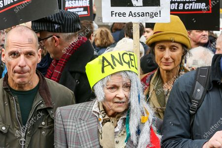 Former Greek Finance Minister Yanis Varoufakis (L) and Vivienne Westwood, British fashion designer (C) wearing an 'ANGEL' headband join supporters of Wikileaks founder protesting outside Australia House in central London against Assange's extradition to the United States where he will face espionage charges.