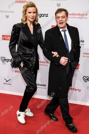 Veronica Ferres (L) and Sylvester Groth arrive for the reception of the Medienboard Berlin-Brandenburg (MBB) during the 70th annual Berlin International Film Festival (Berlinale), in Berlin, Germany, 22 February 2020. The Berlinale runs from 20 February to 01 March 2020.