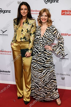 Janina Uhse (L) and Susan Sideropoulos arrive for the reception of the Medienboard Berlin-Brandenburg (MBB) during the 70th annual Berlin International Film Festival (Berlinale), in Berlin, Germany, 22 February 2020. The Berlinale runs from 20 February to 01 March 2020.