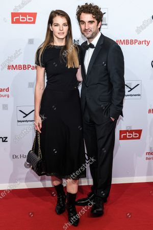 Stock Photo of Yvonne Catterfeld (L) and Oliver Wnuk arrive for the reception of the Medienboard Berlin-Brandenburg (MBB) during the 70th annual Berlin International Film Festival (Berlinale) in Berlin, Germany, 22 February 2020. The Berlinale runs from 20 February to 01 March 2020.