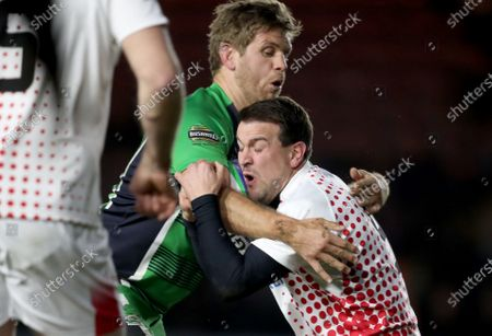 Stock Photo of England vs Ireland. Ireland's Chris Henry and Lee Dickson of England