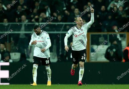 Besiktas' Domagoj Vida (R)  celebrates his goal  during the Turkish Super League match between Besiktas and Trabzonspor  in Istanbul, Turkey, 22 February 2020.