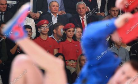 Russian President Vladimir Putin (top C) and chairman of the Russian Sambo Federation Sergei Yeliseyev (top R) attend the 1st Combat Sambo League Championships at the Ice Cube Centre in Sochi, Russia 22 February 2020.