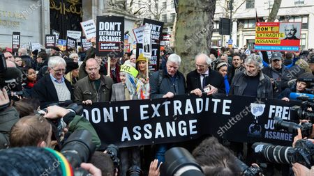 VIPs, including Vivienne Westwood (3L), John Shipton (father of Julian Assange) (2R), Roger Waters from Pink Floyd (R), pose for the media ahead of a march from Australia House in Aldwych to Parliament Square in support of Wikileaks founder Julian Assange. The full extradition trial of Mr Assange begins in London on 24 February.