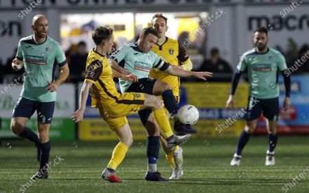John Rooney (blue shirt)  in the thick of the action for Barrow during Sutton United vs Barrow, Vanarama National League Football at the Borough Sports Ground on 22nd February 2020