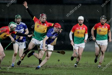 Laois vs Carlow. Laois' Fiachra C Fennell under pressure from Alan Corcoran of Carlow