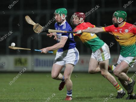 Laois vs Carlow. Laois' Ross King under pressure from Alan Corcoran and David English of Carlow