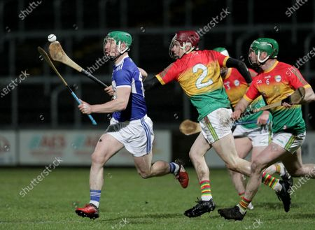 Laois vs Carlow. Laois' Ross King under pressure from Alan Corcoran of Carlow