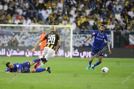 Al-Hilal's Sebastian giovinco (L) in action against AL- Ittihad's Karim EL Ahmadi (C) And Al-Hilal's Salman Alfaraj (R) during the Saudi Professional League soccer match between Al-Hilal and AL- Ittihad at King Saud University Stadium, Riyadh, Saudi Arabia, 22 February 2020.