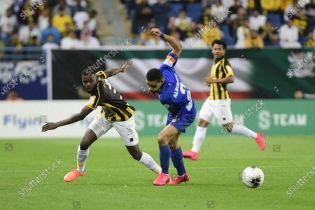 Al-Hilal's Mohammed al burayk (R) in action against AL- Ittihad's Abdulaziz Al Bishi (L) during the Saudi Professional League soccer match between Al-Hilal and AL- Ittihad at King Saud University Stadium, Riyadh, Saudi Arabia, 22 February 2020.