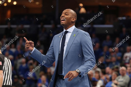 Stock Image of Memphis head coach Penny Hardaway calls to his team in the first half of an NCAA college basketball game against Houston, in Memphis, Tenn