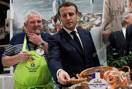 French President Emmanuel Macron (R) visits the French fishing stand during the 57th International Agriculture Fair (Salon de l'Agriculture) at the Porte de Versailles exhibition center in Paris, France, 22 February 2020. The International Agriculture Fair 'Salon International de l'agriculture' (SIA) at the Paris Expo Porte de Versailles runs from 22 February to 01 March 2020.