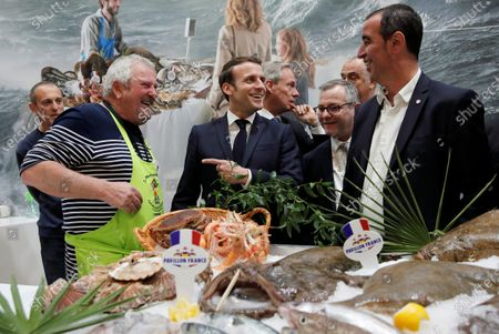 French President Emmanuel Macron (C) visits the French fishing stand during the 57th International Agriculture Fair (Salon de l'Agriculture) at the Porte de Versailles exhibition center in Paris, France, 22 February 2020. The International Agriculture Fair 'Salon International de l'agriculture' (SIA) at the Paris Expo Porte de Versailles runs from 22 February to 01 March 2020.