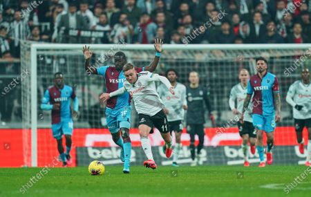 Tyler Boyd of Besiktas in front of Badou Ndiaye of Trabzonspor during Besiktas against Trabzonspor on Vodafone Park, Istanbul, Turkey