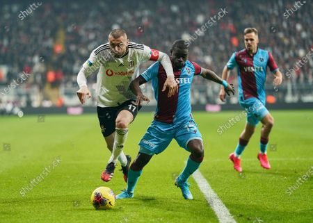 Burak Yilmaz of Besiktas going past Badou Ndiaye of Trabzonspor during Besiktas against Trabzonspor on Vodafone Park, Istanbul, Turkey