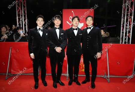 Lee Je-hoon, Park Jeong-min, Ahn Jae-hong, and Park Heo-soo arrive for the premiere of 'Sa-Nyang-Eui-Si-Gan (Time to Hunt)' during the 70th annual Berlin International Film Festival (Berlinale), in Berlin, Germany, 22 February 2020. The movie is presented in the Berlinale Special section at the Berlinale that runs from 20 February to 01 March 2020.