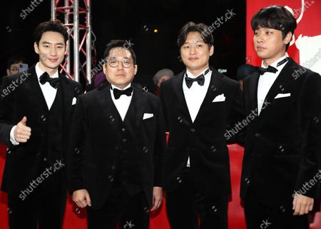 Lee Je-hoon, Handae Rhee, director Yoon Sung-hyun, and Park Jeong-min arrive for the premiere of 'Sa-Nyang-Eui-Si-Gan (Time to Hunt)' during the 70th annual Berlin International Film Festival (Berlinale), in Berlin, Germany, 22 February 2020. The movie is presented in the Berlinale Special section at the Berlinale that runs from 20 February to 01 March 2020.