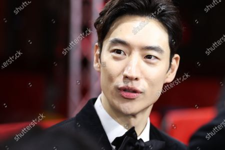 Lee Je-hoon arrives for the premiere of 'Sa-Nyang-Eui-Si-Gan (Time to Hunt)' during the 70th annual Berlin International Film Festival (Berlinale), in Berlin, Germany, 22 February 2020. The movie is presented in the Berlinale Special section at the Berlinale that runs from 20 February to 01 March 2020.