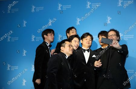 Park Jeong-min, Handae Rhee, Lee Je-hoon, Park Heo-soo, director Yoon Sung-hyun, and Ahn Jae-hong pose for a selfie with Berlinale artistic director Carlo Chatrian at the premiere of 'Sa-Nyang-Eui-Si-Gan (Time to Hunt)' during the 70th annual Berlin International Film Festival (Berlinale), in Berlin, Germany, 22 February 2020. The movie is presented in the Berlinale Special section at the Berlinale that runs from 20 February to 01 March 2020.