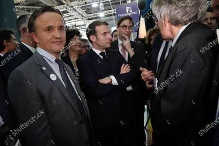 French President Emmanuel Macron (C) and Philippe Mauguin (L), head of INRAE, French national research Institute for agriculture, food and environment visit the INRAE (French national research Institute for agriculture, food and environment) at the International Agriculture Fair (Salon de l'Agriculture) at the Porte de Versailles exhibition center in Paris, France, 22 February 2020. The International Agriculture Fair 'Salon International de l'agriculture' (SIA) at the Paris Expo Porte de Versailles runs from 22 February to 01 March 2020.