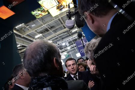 French President Emmanuel Macron (C) visits the INRAE (French national research Institute for agriculture, food and environment) at the International Agriculture Fair (Salon de l'Agriculture) at the Porte de Versailles exhibition center in Paris, France, 22 February 2020. The International Agriculture Fair 'Salon International de l'agriculture' (SIA) at the Paris Expo Porte de Versailles runs from 22 February to 01 March 2020.
