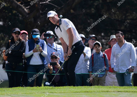 Danny Willett of England follows his ball to the first green during the third round for the WGC-Mexico Championship golf tournament, at the Chapultepec Golf Club in Mexico City