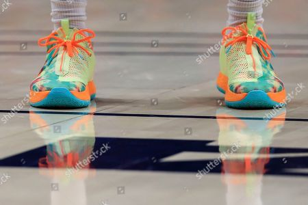 A view of the Nike Paul George shoes worn by Dayton's Trey Landers (3) in the first half of an NCAA college basketball game against Duquesne, in Dayton, Ohio. Dayton won 80-70
