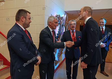 Prince William greets Welsh Rugby Union (WRU) Chairman Gareth Davies (second left) and Chief Executive Martyn Phillips (left), as he attends the Six Nations match between Wales and France at the Principality Stadium