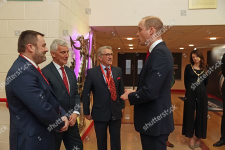 Stock Photo of Prince William greets Welsh Rugby Union (WRU) Chairman Gareth Davies (second left) and Chief Executive Martyn Phillips (left), as he attends the Six Nations match between Wales and France at the Principality Stadium